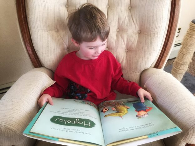 unique gifts for 3 year old boys, boy reading a book