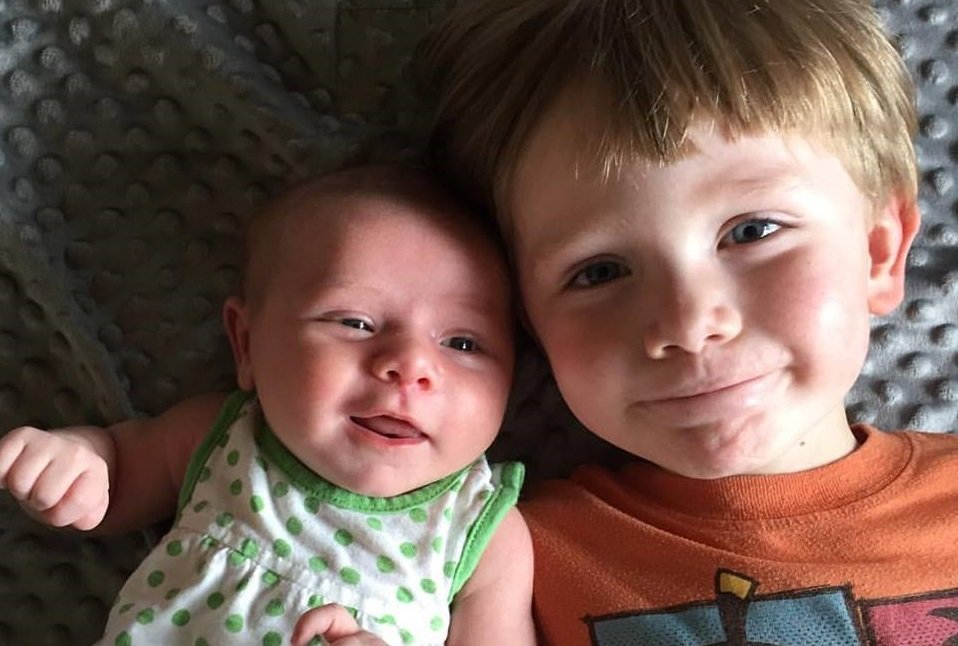 brother and newborn sister rigel celeste