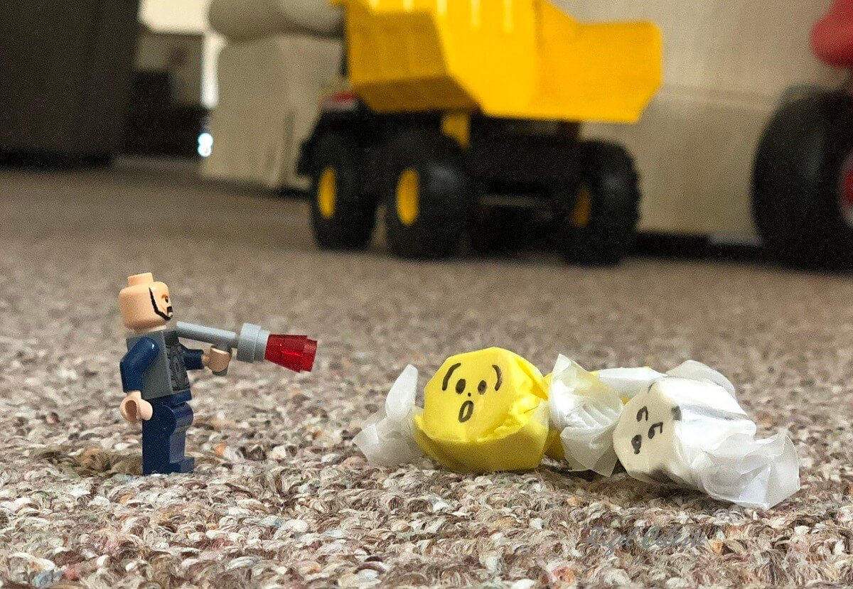 How to get taffy out of carpet, lego man pointing gun at surprised and scared taffy on carpeting