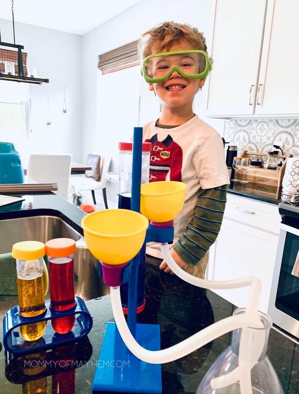 preschooler with science experiment kit